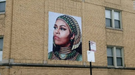 An artist creates a mural of Michelle Obama and nobody's happy
