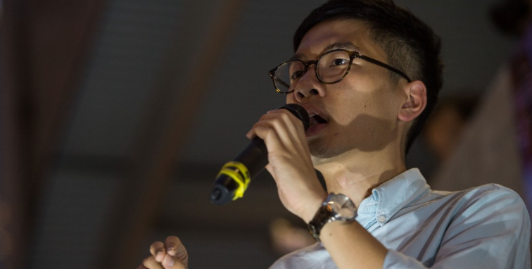 Hong Kong lawmaker under threat vows to fight