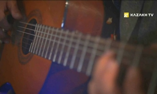 A NATIONAL HARMONY INCLUDED THE GUITAR